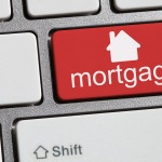 Keyboard with single red button showing the word mortgage
